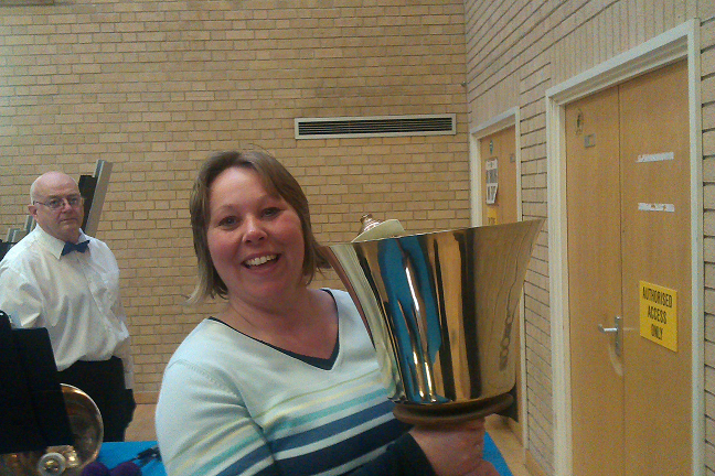 Picture of Amanda holding the largest handbell