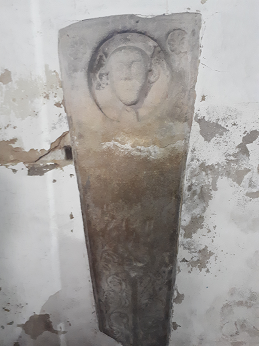 Coffin lid in wall